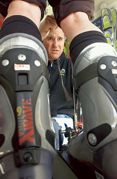 Jim Schaffner uses a plumb bob to check a client's knee position over the feet. The procedure tells Schaffner whether a skier is knock-kneed or bow-legged.